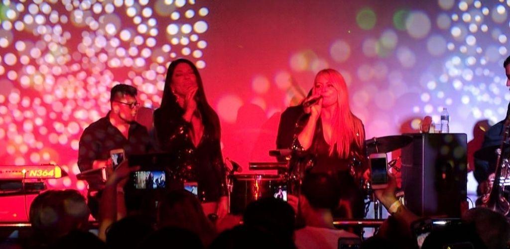 Two women singing live at Luna Nightclub in Durham