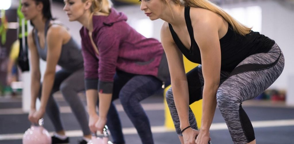 Cute Edmonton singles working out at Full Force Fitness Club