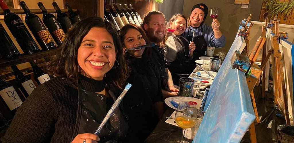 A BBW in Long Beach enjoying an art class at Brushtrokes and Beverages, East Village