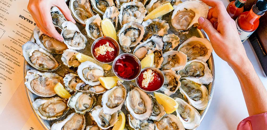 A platter of fresh oysters from Jax Fish House and Oyster Bar