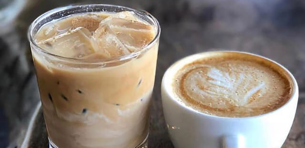 An iced latte and latte art from Kinsley House