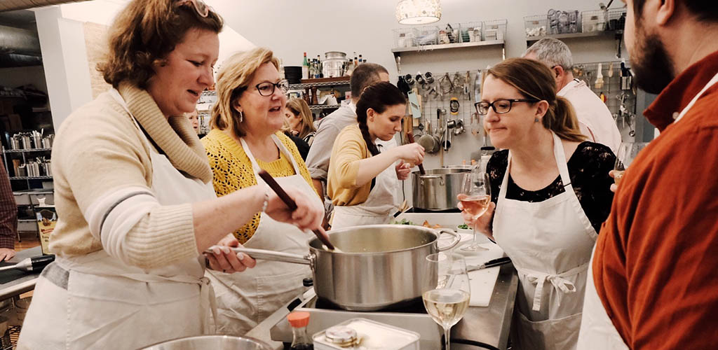 Women in a cooking class at Schola