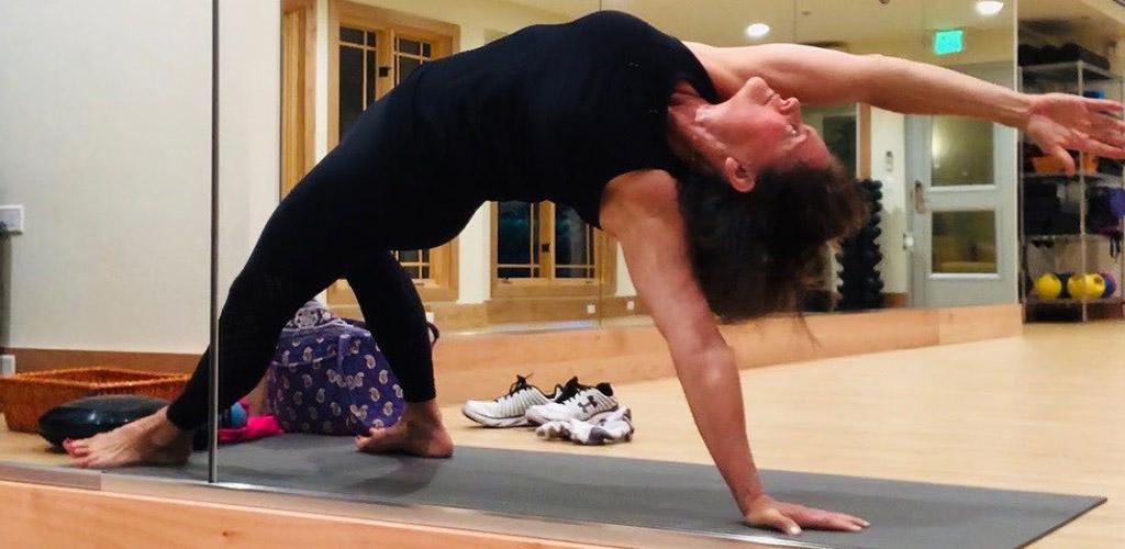 A woman doing yoga at Surya Yoga