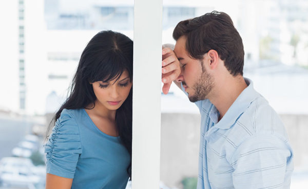 sad couple wondering how to know when their relationship is over