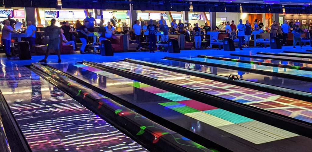 The bright neon lanes at West Seattle Bowl