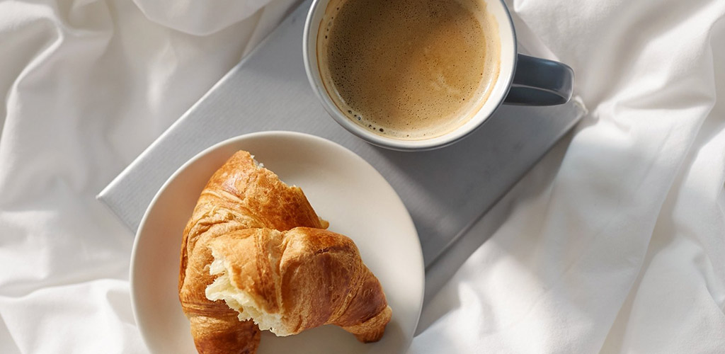 A croissant and coffee from Avril Supermarche