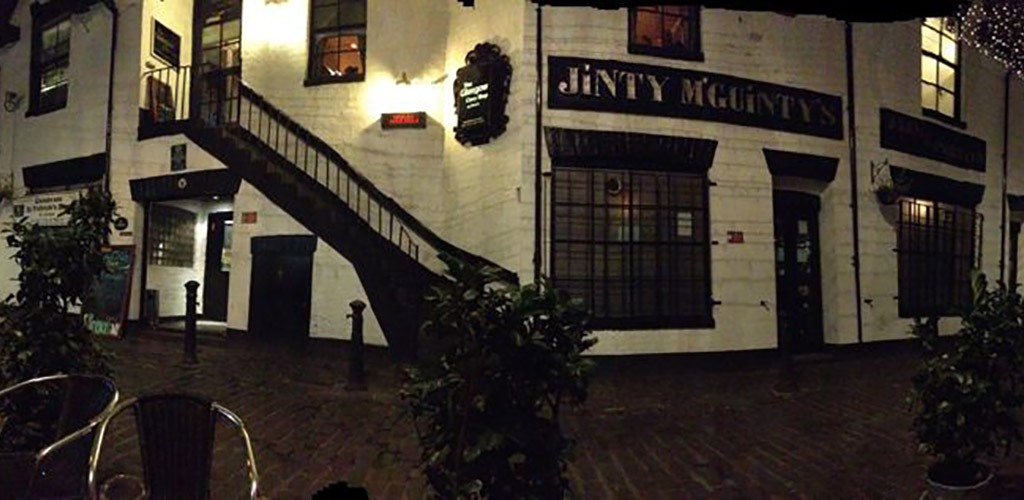 Exterior of Jinty McGuinty's Irish Bar at night