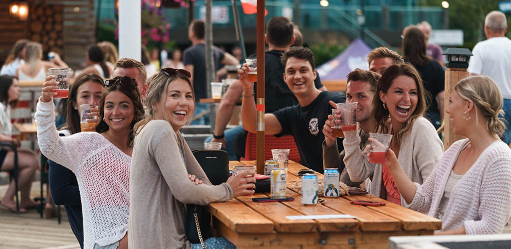 Friends having a great time at The Stubborn Goat Beer Garden