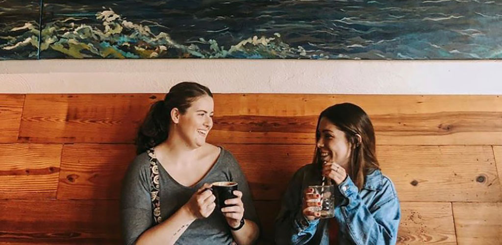 Friends enjoying some coffee from Three Ships Coffee