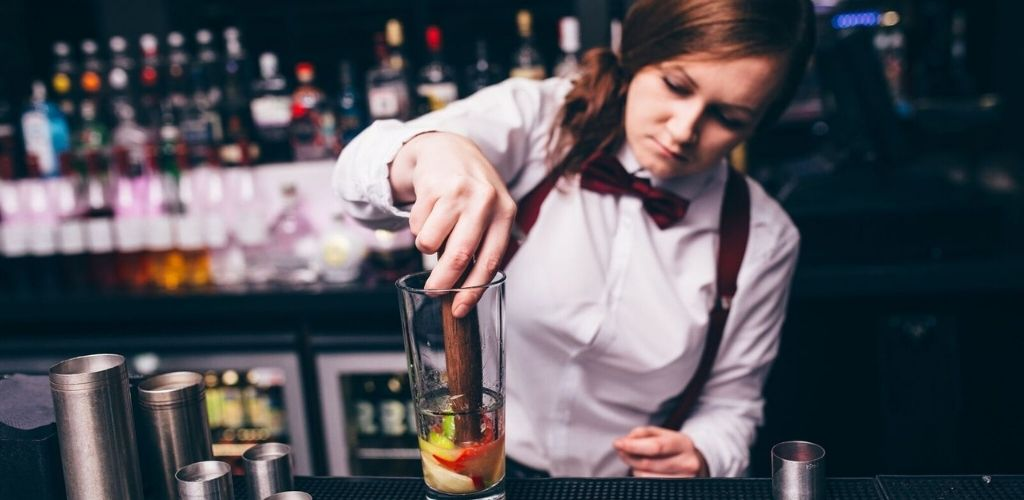 A cute Glasgow bartender mixing cocktails in