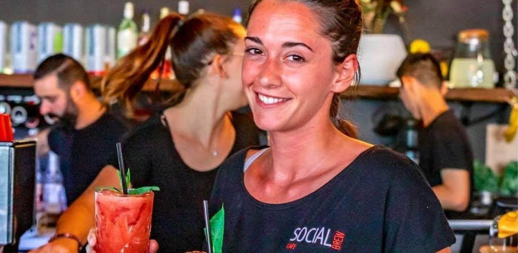 A cute barista serving smoothies at Social Brew Cafe in Sydney