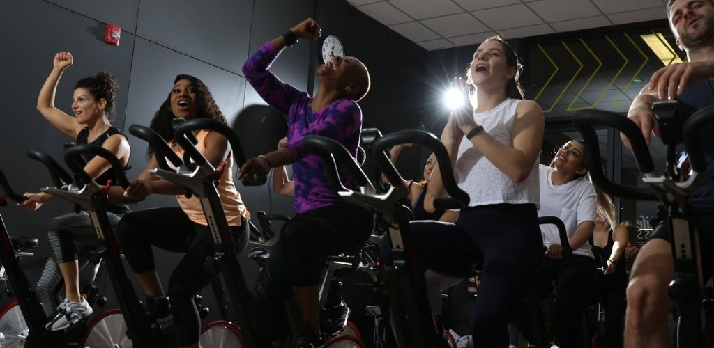 Cute Brampton singles in a spinning class at GoodLife Fitness