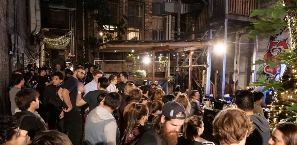 Brisbane singles attending a live event at Coffee Iconic