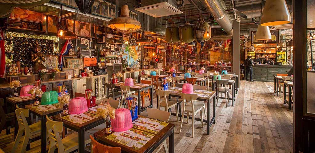 The colorful dining area of Thaikun Street Bar