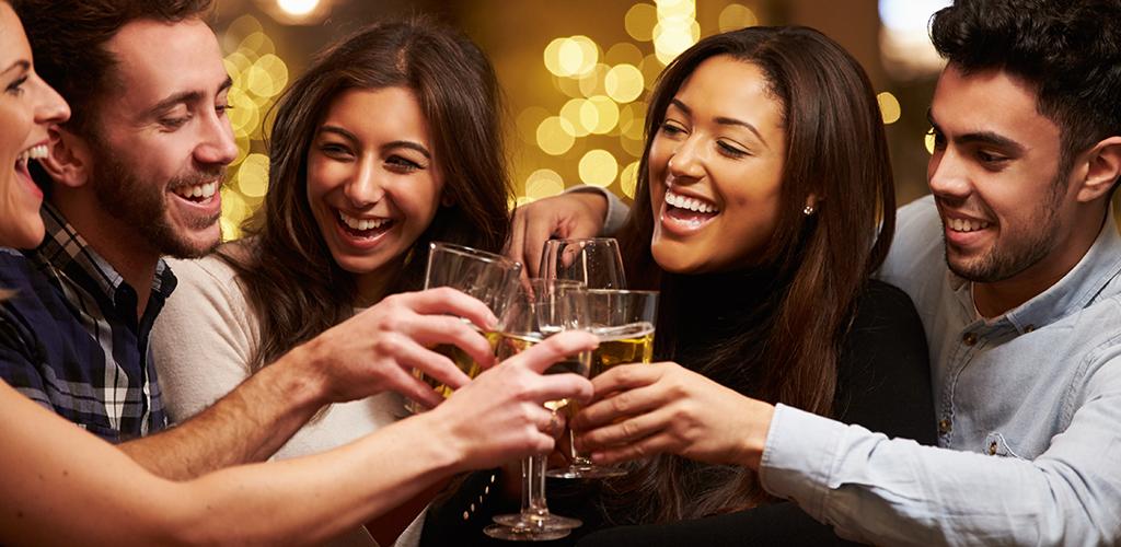 Attractive men and women in bar looking for Leeds hookups
