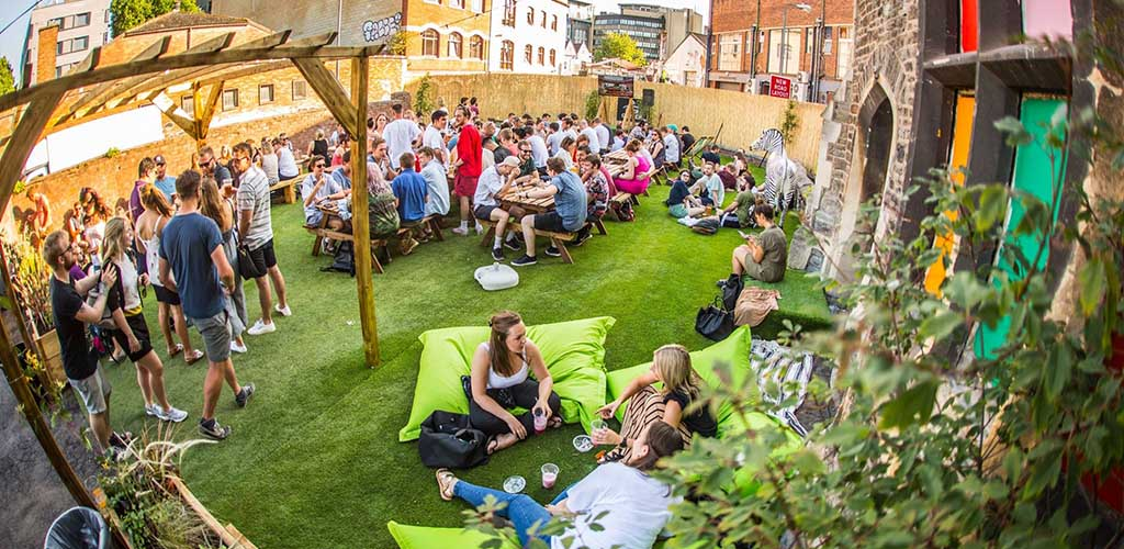The sunny outdoor area of Stokes Croft Beer Garden where you can find Bristol hookups