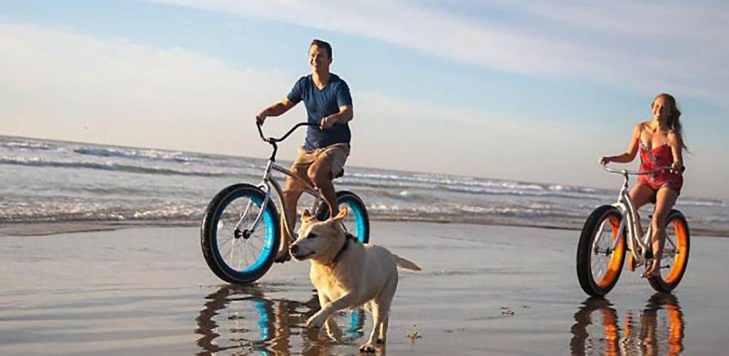 Biking along the beach at Padre Island Beach