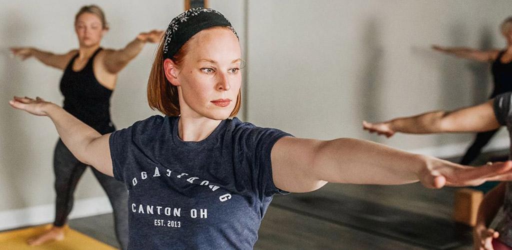 Women doing yoga at Yoga Strong Studio