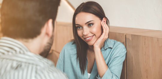 Woman with a man who knows how to build sexual tension even if they've just met
