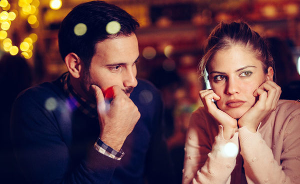 Man struggling with how to understand a woman while on a date