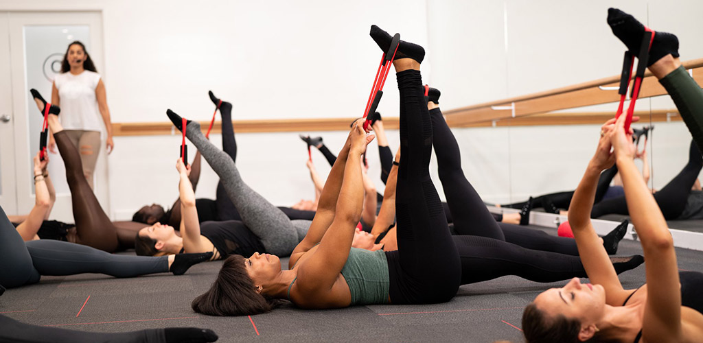 Women doing barre exercises at Pure Barre