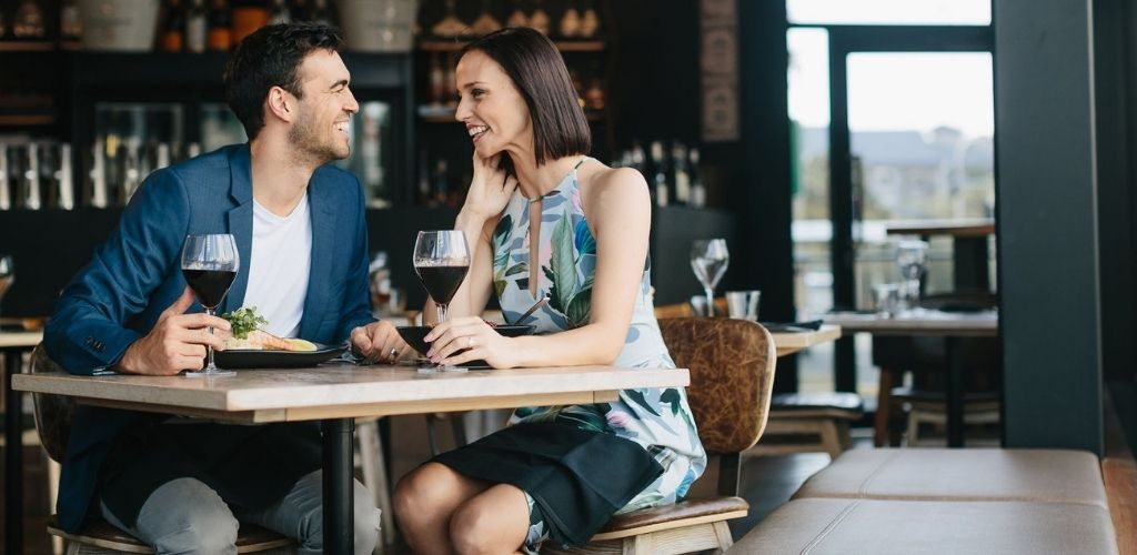 A couple flirting and drinking on a date at Social House Gold Coast