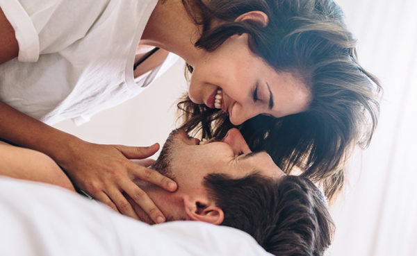 couple in bed after man learns how to get a girl to like you again