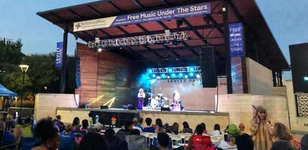 An outdoor musical performance at Levitt Pavilion