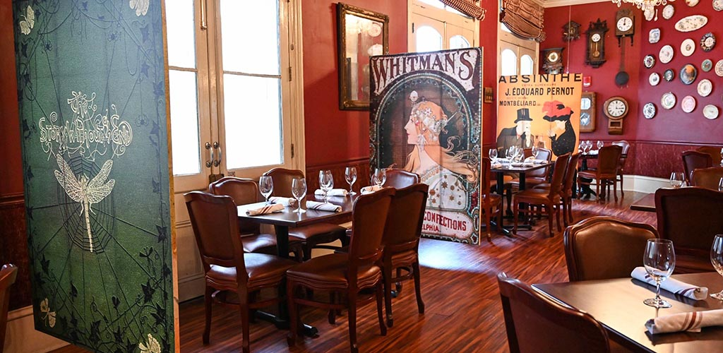 The rustic art-filled dining area of Muriel's