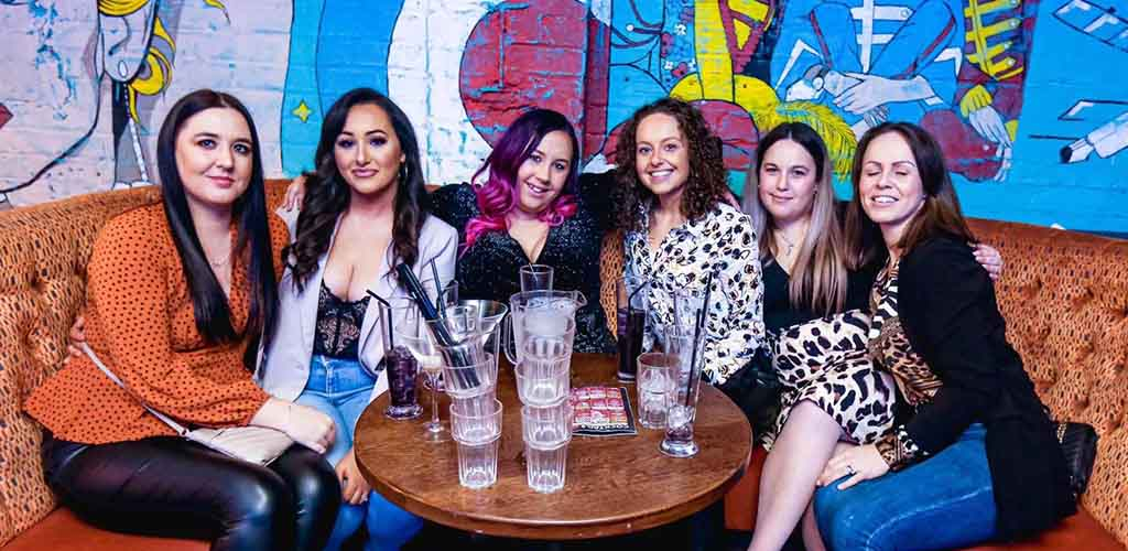 Six Cardiff ladies with drinks at Retro