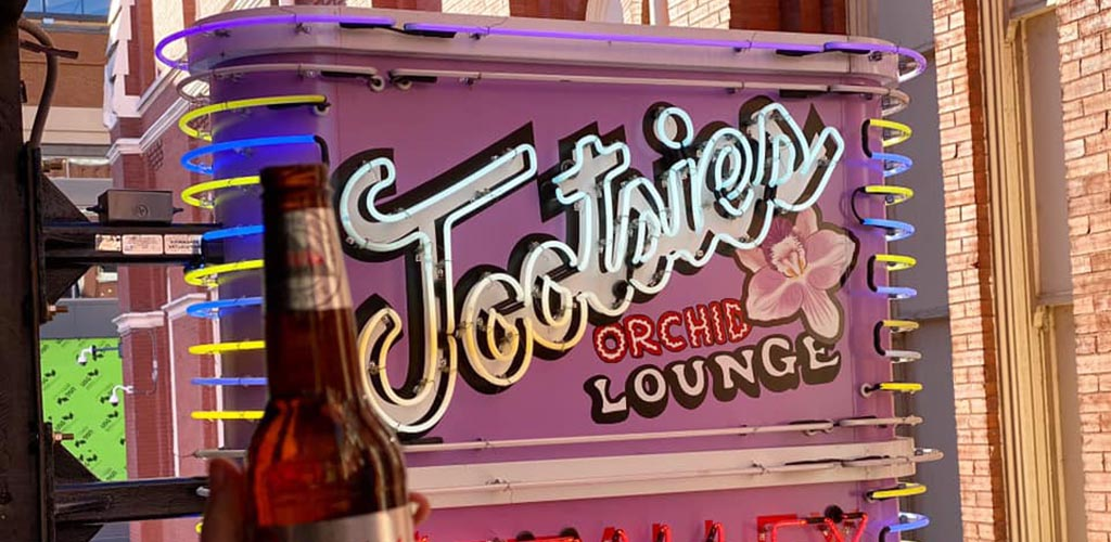 The pink sign of Tootsie's Orchid Lounge