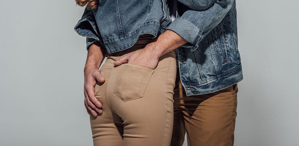 Man grabbing a girl's butt