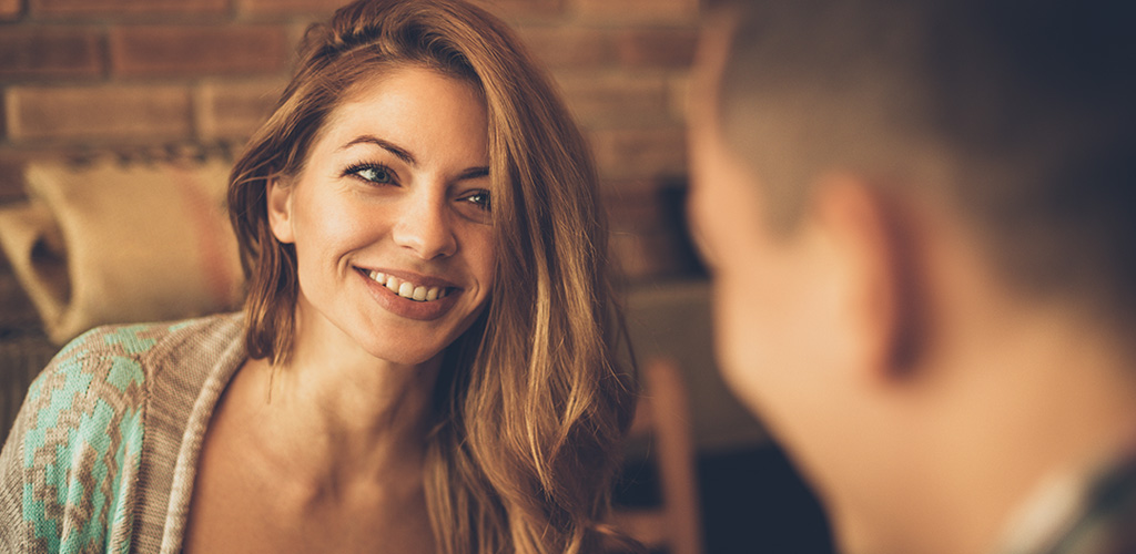 couple flirting after discovering what attracts women to men
