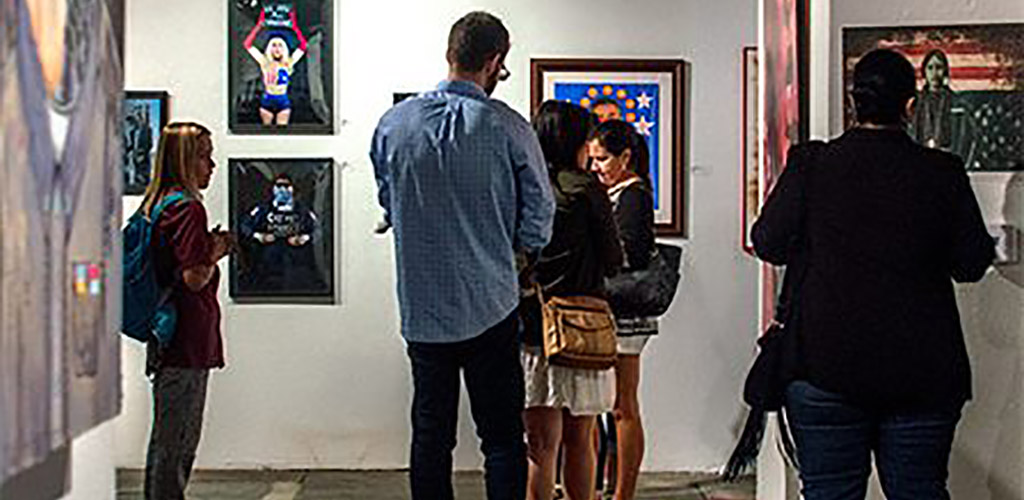 People viewing the paintings at The Museum of Contemporary Art