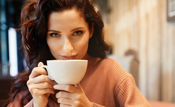 Single woman in Vancouver drinking coffee at a cafe