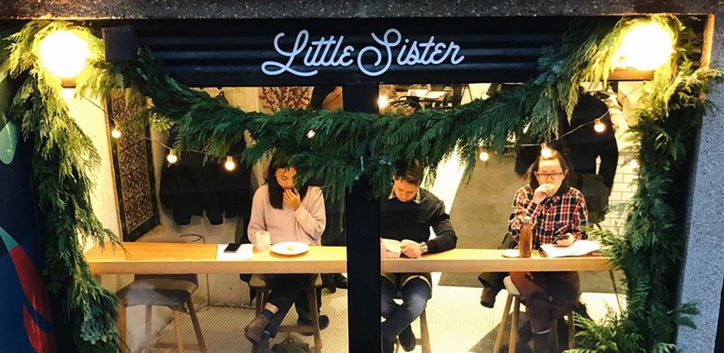 Coffee and fun with single women seeking men in Winnipeg at Little Sister Coffee Maker