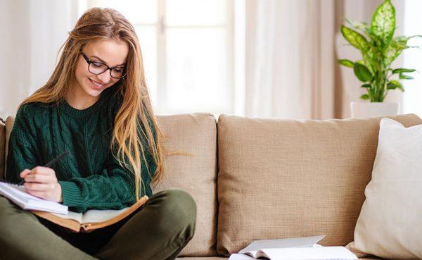 Single Jacksonville girl studying in the living room