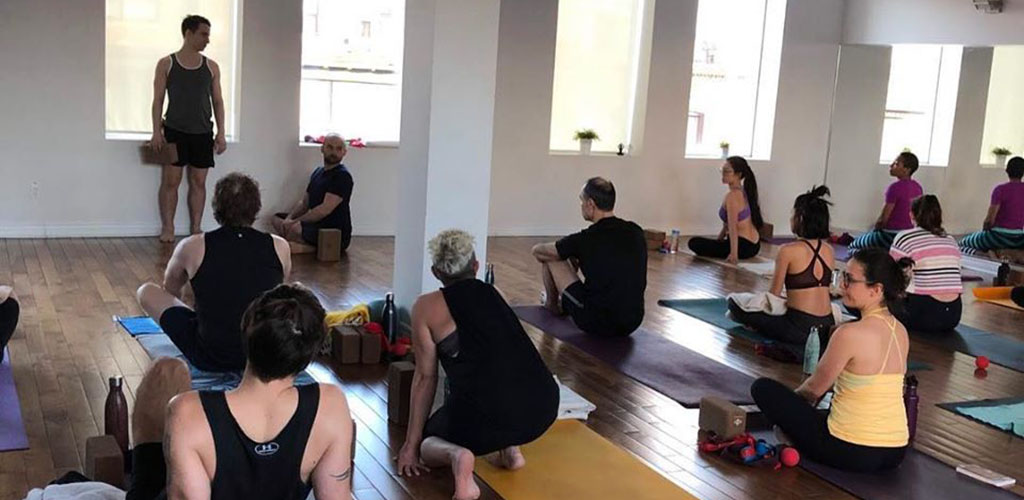 Get out of your comfort zone to meet single women in Toronto at Union Yoga and Wellness