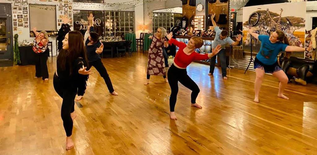 Men and women in a dance class at Danceville U.S.A.