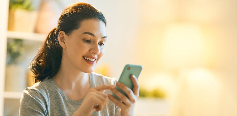 Beautiful woman wondering how Tinder works