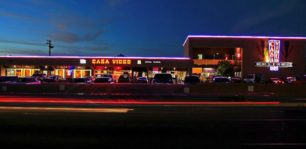 Exterior of Casa Video and Casa Film Bar at night