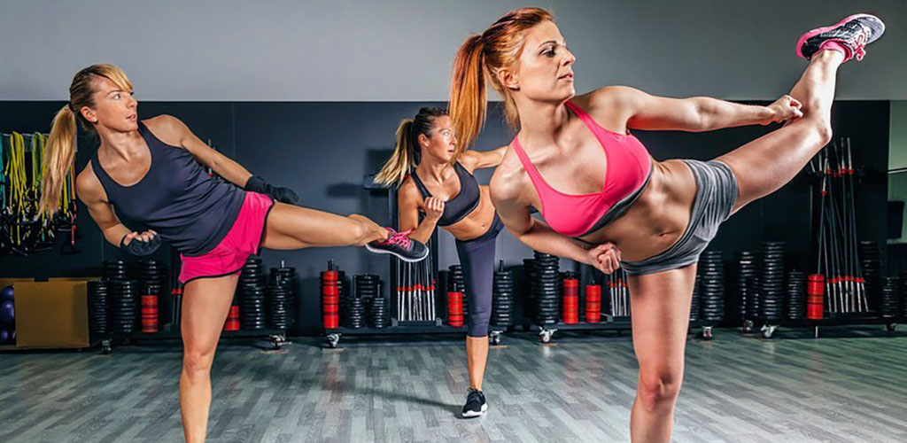 Women at a kickboxing class at Full Force Fitness Club