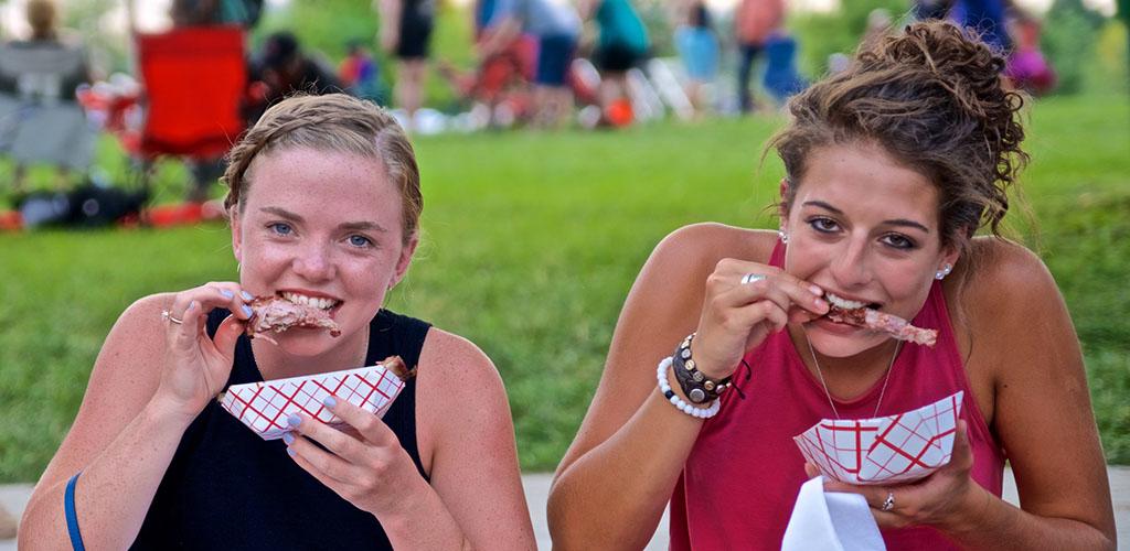 Cute girls enjoying ribs at The Jazz & Rib Fest