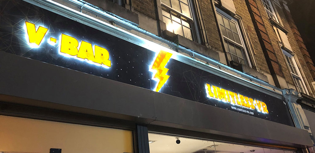 The bright neon sign of Limitless Virtual Reality Cafe