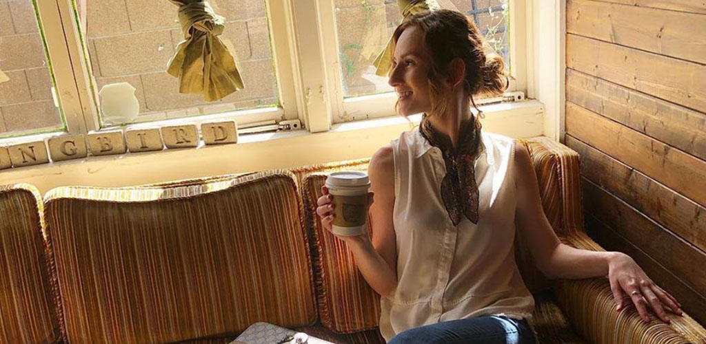 A beautiful Phoenix single woman drinking tea in the afternoon at Songbird Coffee & Tea House