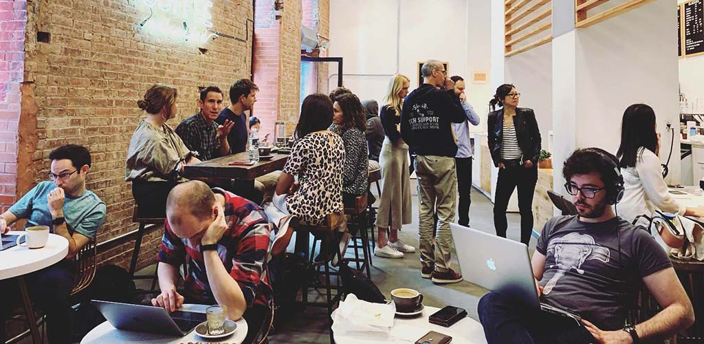 A crowd of young professionals at Coffee Project NY