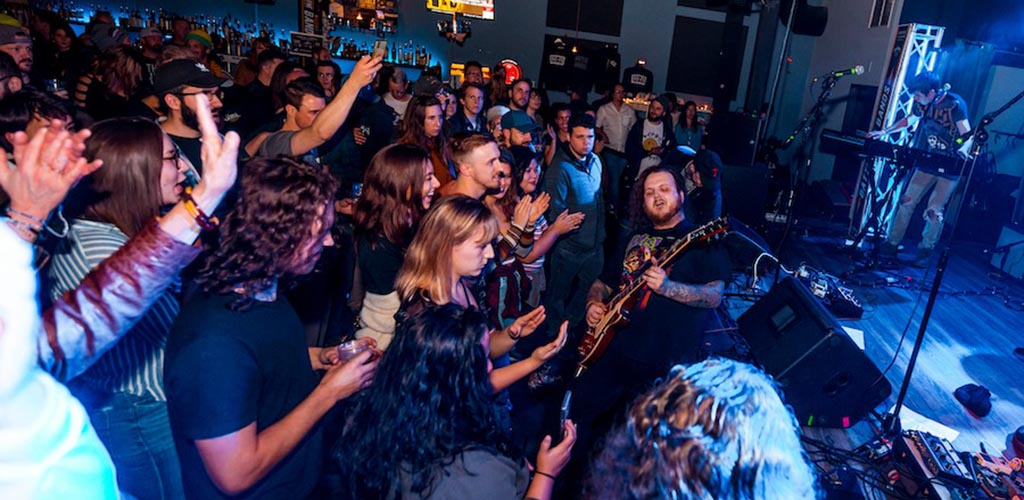 A lively musical performance at Hi-Fi featuring a rock band