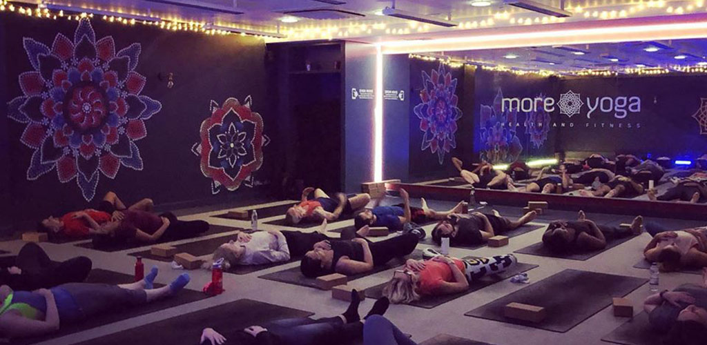 A MoreYoga class with ambient lighting