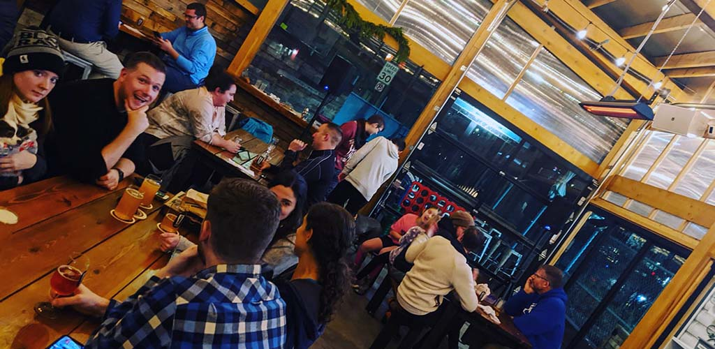 Ounces Taproom with young people hanging out