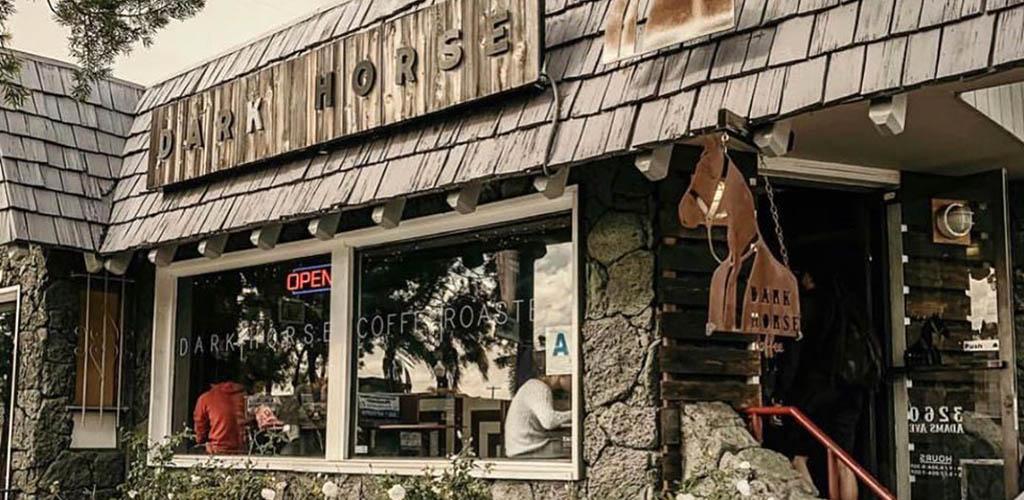 The rustic facade of Dark Horse Coffee Roasters
